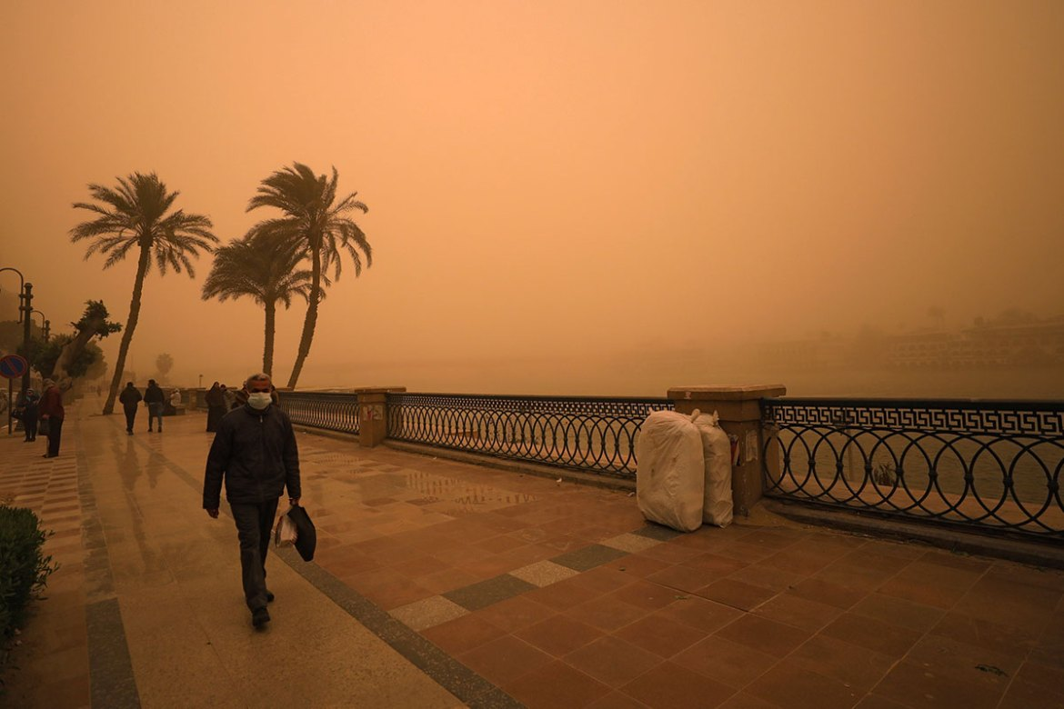 Egypt's sky turned an ominous shade of orange. [Mohamed Abd El Ghany/Reuters]