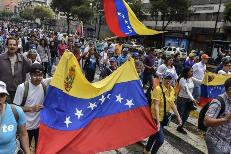 Thousands of protesters took to the streets of Venezuela's capital Caracas on Wednesday [AFP]