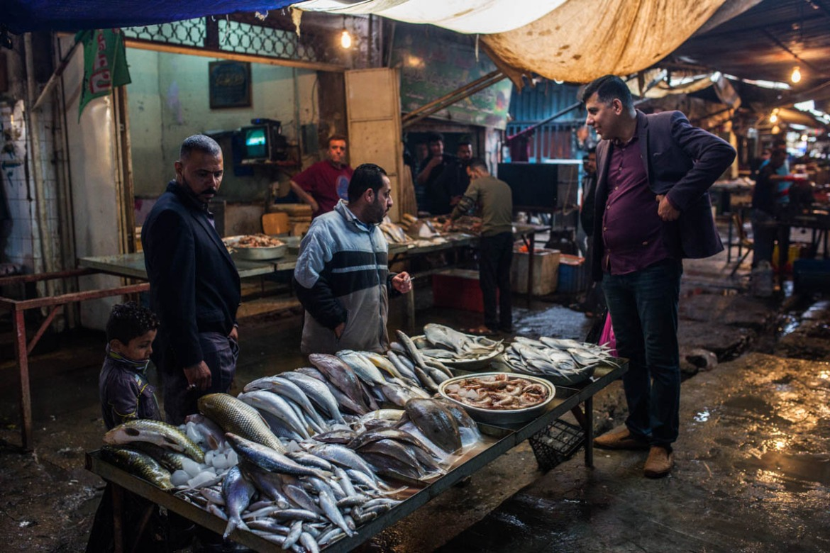 Fresh fish arrives daily at Basra fish market from the port town of Faw, on the shores of the Gulf. The seawater is not as polluted and contaminated as the river in the city. [Alessio Mamo/Al Jazeera]