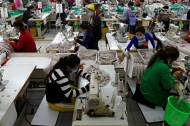 Employees at a Cambodian clothes factory. The EU is threatening to remove trade privileges over the government's crackdown on human rights [File: Samrang Pring/Reuters]