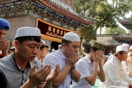 Rights groups have accused China of engaging in a campaign of ethnic cleansing against Muslims [Thomas Peter/Reuters]