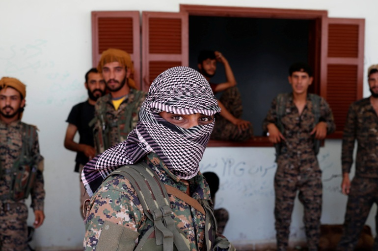 It's estimated 50,000 Kurdish fighters from the People's Protection Units (YPG) died battling the ISIL [Goran Tomasevic/Reuters]