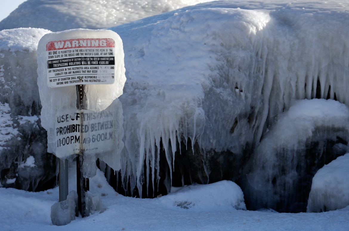 A deadly Arctic deep freeze enveloped the Midwest with record-breaking temperatures on Wednesday. [Nam Y Huh/AP Photo]