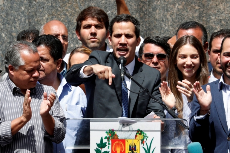 Venezuela's opposition leader Juan Guaido speaks during a news conference in Caracas on January 25, 2019 [Reuters/Carlos Garcia Rawlins]