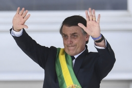 Brazil''s new President Jair Bolsonaro gestures after receiveing the presidential sash during his inauguration ceremony [Evaristo SA/AFP]