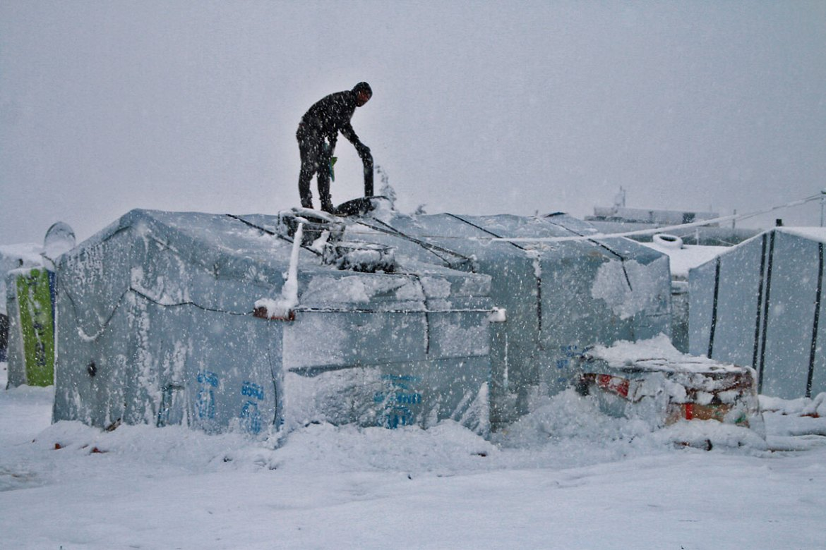 Heavy snow fell on the refugee camps in Lebanon's Bekaa Valley. [AFP]