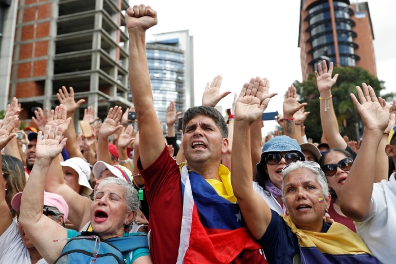 Opposition supporters take part in a rally against Venezuelan President Nicolas Maduro''s government and to commemorate the 61st anniversary of the end of the dictatorship of Marcos Perez Jimenez in Caracas, Venezuela January 23, 2019. [Carlos Garcia Rawlins/Reuters]