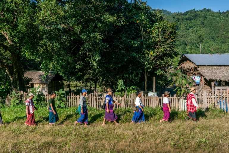 Karen villagers file in to witness the signing of the Salween Peace Park Charter in Mutraw District in December 2018 [Matias Bercovich/Al Jazeera]