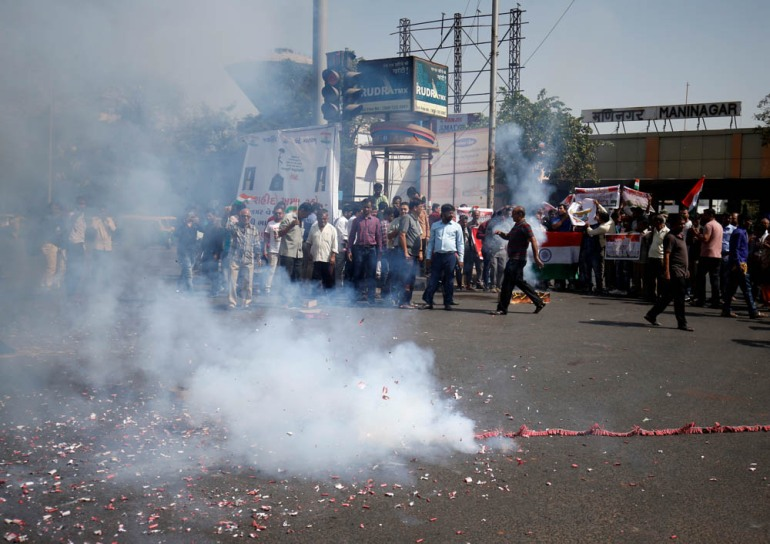 People in Ahmedabad burn firecrackers to celebrate after Indian jets conducted air raids on alleged rebels camps inside Pakistan. [Amit Dave/Reuters]