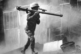 A South Vietnamese soldier with a bazooka advances along a Saigon Street in this February 2, 1968 photo [File: AP]