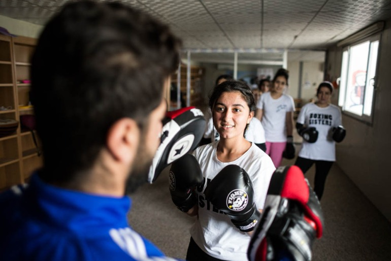 At the moment, the Boxing Sisters are being taught by a male kickboxing instructor who comes from Dohuk, the nearest city. Soon, some of them will be trained by retired professional boxer Cathy Brown to become trainers themselves. Husna is the first candidate for that training. [Giacomo Sini/Al Jazeera]