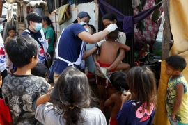 Philippine National Red Cross and Health Department volunteers conduct house-to-house measles vaccination for children in an informal settlers community in Manila following a measles outbreak that already spread to four regions in the country and claimed the lives of more than five dozen victims Saturday, Feb. 16, 2019 [Bullit Marquez/AP]