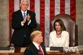 Speaker of the House Nancy Pelosi and Vice President Mike Pence react to President Donald Trump's second State of the Union address on February 6, 2019 [Leah Millis/Reuters]