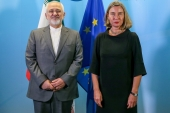 Iran's Foreign Minister Mohammad Javad Zarif is seen next to EU Foreign Policy Chief Federica Mogherini before a meeting in Brussels, Belgium, April 25, 2018 [File: Stephanie Lecocq/Reuters]
