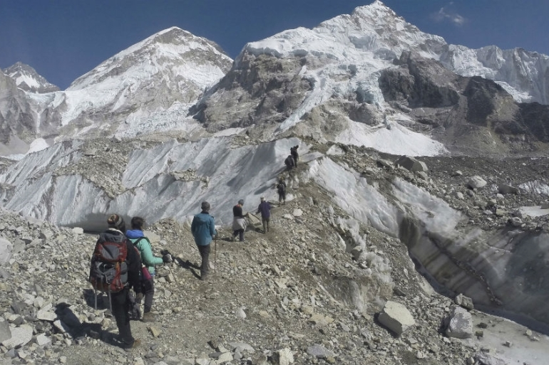 Trekkers at a glacier at the Mount Everest in Nepal. A new report warns two-thirds of Himalayan glaciers could vanish by 2100 if global emissions are unchecked  [File: Tashi Sherpa/AP Photo]