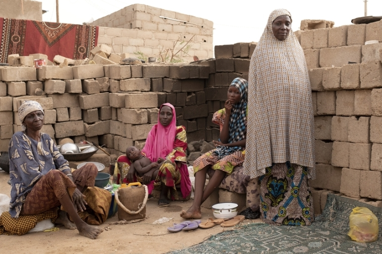 Habi Amaloze, right, lost her source of income when a ban on irregular migration was enforced in Agadez in 2016. Now she earns about five cents a day selling peanuts [Francesco Bellina/Al Jazeera]
