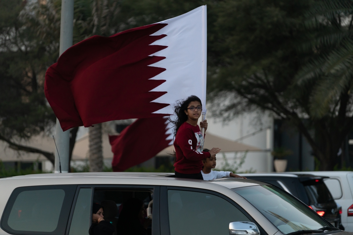 People of all ages turned up in huge numbers to welcome the team back to Qatar. [Sorin Furcoi/Al Jazeera]