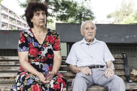 A 'badante', or carer, from Moldova pictured with her Italian employer in a park from Rome [Romina Vinci/Al Jazeera]