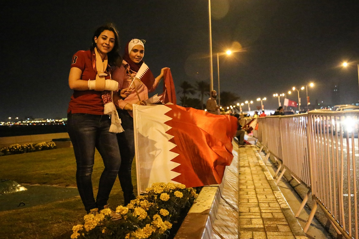 Marwa (right) and Mais, both from Syria, were supporting Qatar because the country was 'supporting Syria from the beginning and all Arab countries like Palestine'. [Showkat Shafi/Al Jazeera]