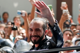 Presidential candidate Nayib Bukele waves to supporters after casting his ballot in San Salvador [Jose Cabezas/Reuters]