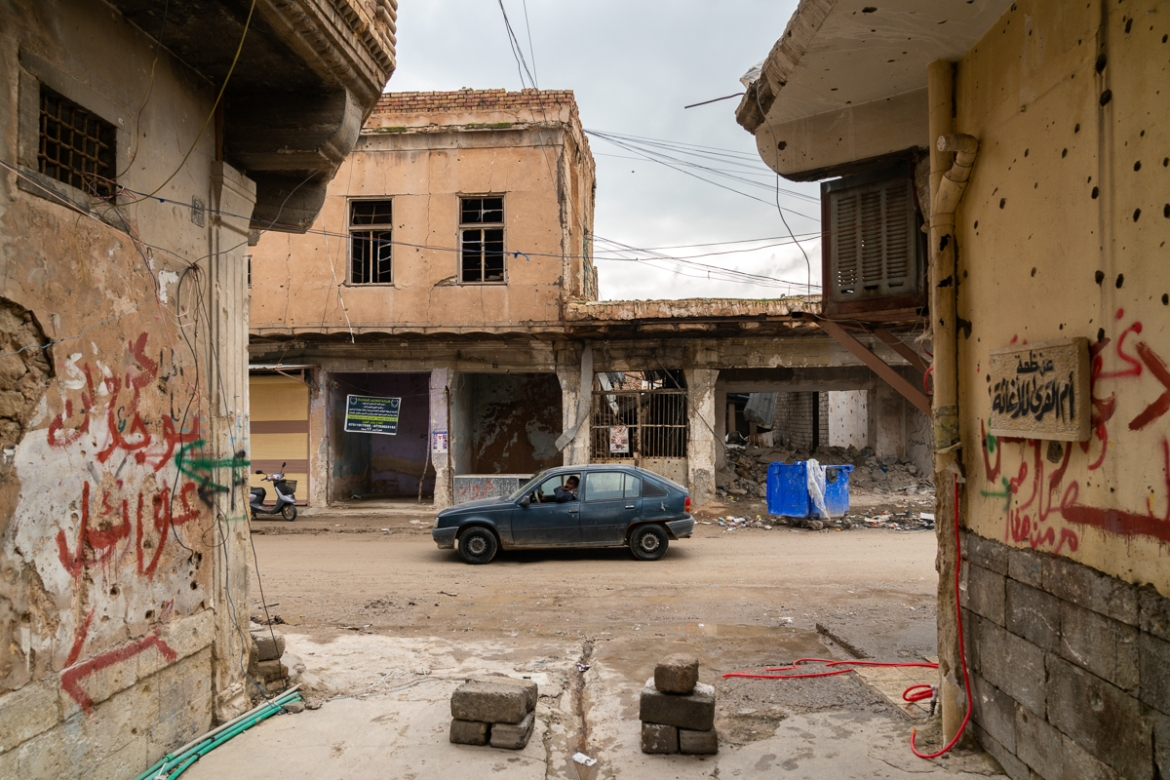 Most neighbourhoods in the Old City of Mosul are in ruins but people are beginning to come back, despite the lack of public services like sewage and water. [Emre Rende/Al Jazeera]