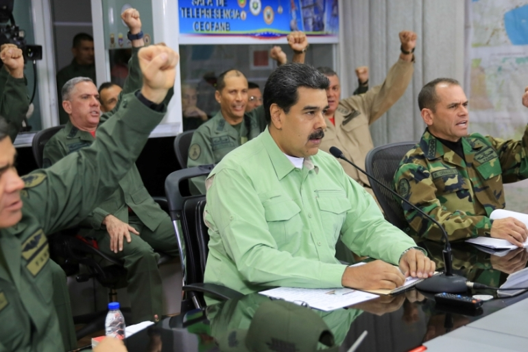 Venezuela's President Nicolas Maduro takes part in a video conference with members of the military in Caracas [Reuters/Miraflores]