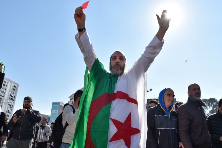 Activists used social media to call for Friday rallies against Bouteflika across the country [Ryad Kramdi/AFP]