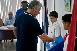 Cuba's President Miguel Diaz-Canel votes during a referendum to approve or reject the new constitution in Havana, Cuba [Ramon Espinosa/AP Photo]