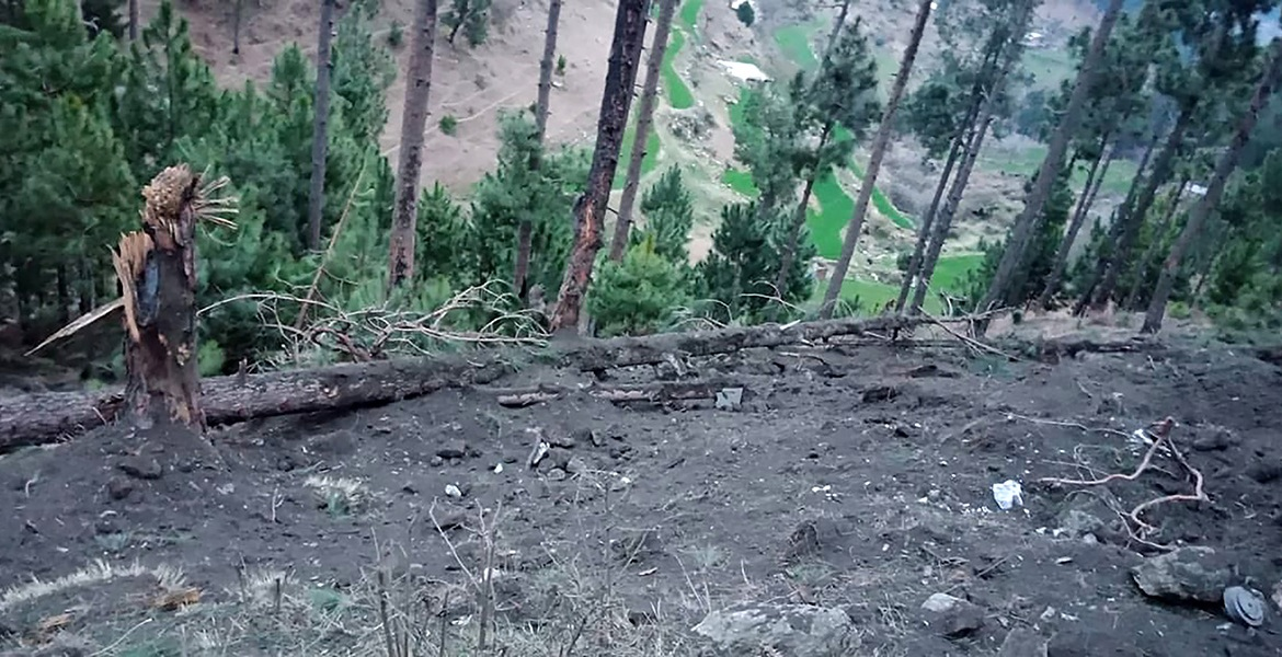 This handout photograph released by Pakistan's Inter-Services Public Relations (ISPR) on February 26, 2019, shows damage caused to trees in a hilly area after the Indian air force dropped their payload in the Balakot area. [ISPR/AFP]