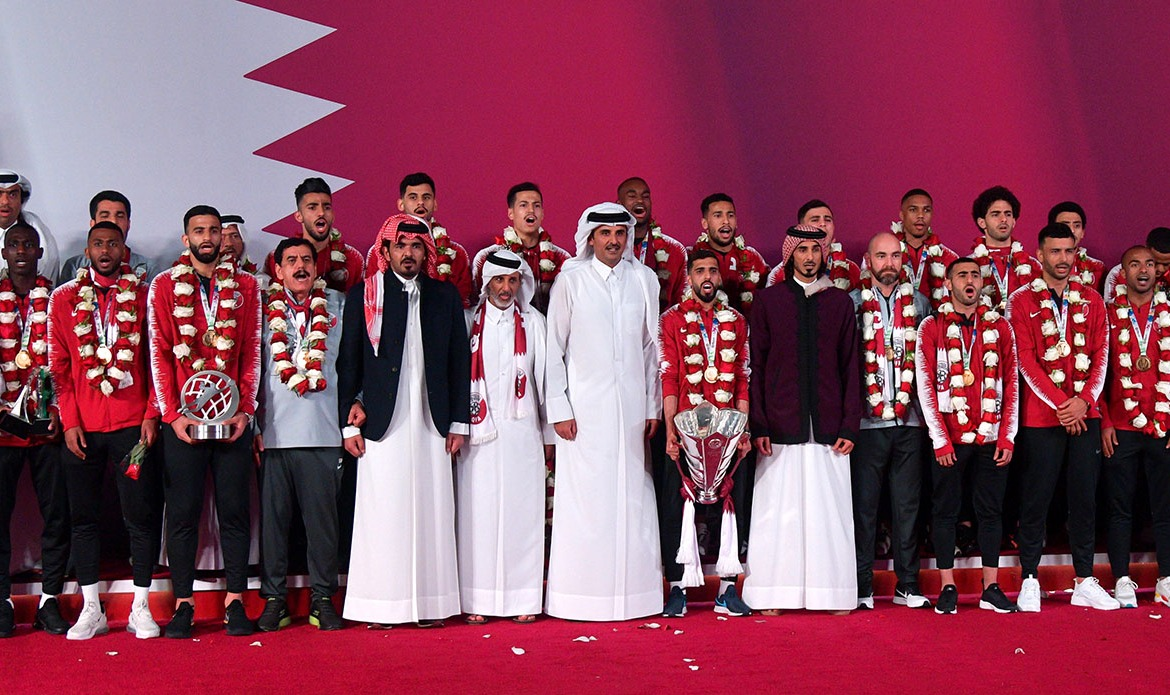 Qatar's Emir, Sheikh Tamim bin Hamad Al Thani (centre), welcomed the national football team in Doha on Saturday. [Noushad Thekkayil/EPA]