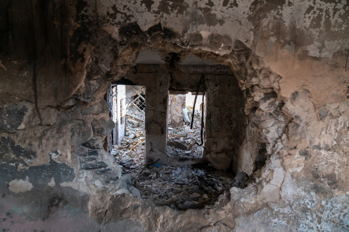ISIL fighters blew large holes between buildings so that they could move freely from one to another during coalition air attacks. [Emre Rende/Al Jazeera]