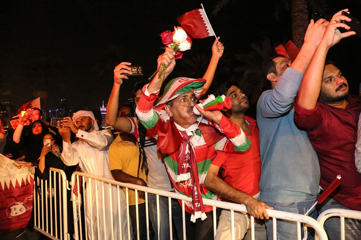 As the team bus finally made its way along the Corniche, screams and cheers filled the air with fans waving flags, blowing horns and throwing flowers. [Showkat Shafi/Al Jazeera]