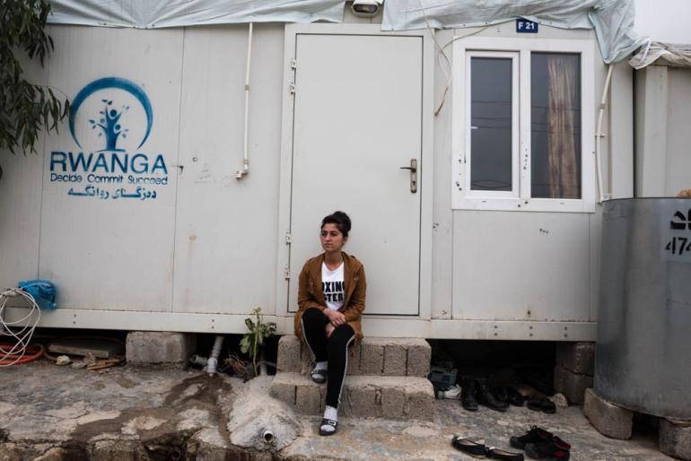 'I love life and I don't hate anyone. I can trust and be friends with all who want to help others, regardless of their faith, race or gender, ' says Husna, seated in front of her temporary house in the camp. [Giacomo Sini/Al Jazeera]