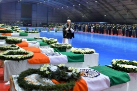 Modi pays tribute as he walks next to the coffins containing the remains of CRPF [Reuters]