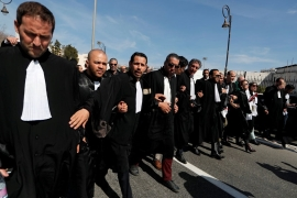 Lawyers march during a protest on Thursday seeking Bouteflika's disqualification [Zohra Bensemra/Reuters]
