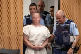 Brenton Tarrant, charged for murder in relation to the mosque attacks, is lead into the dock for his appearance in the Christchurch District Court, New Zealand on March 16 [Mark Mitchell/Reuters]