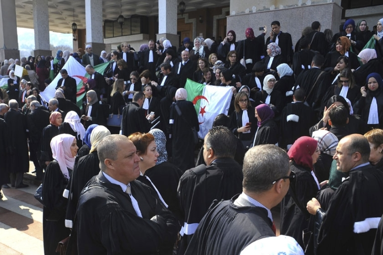 Algerian lawyers gather outside the Algiers court house on Monday. [Fateh Guidoum/AP]