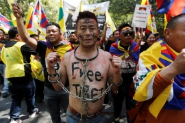 A Tibetan chains himself during a protest held to mark the 60th anniversary of the Tibetan uprising against Chinese rule, in New Delhi, India, March 10, 2019 [Adnan Abidi/Reuters]