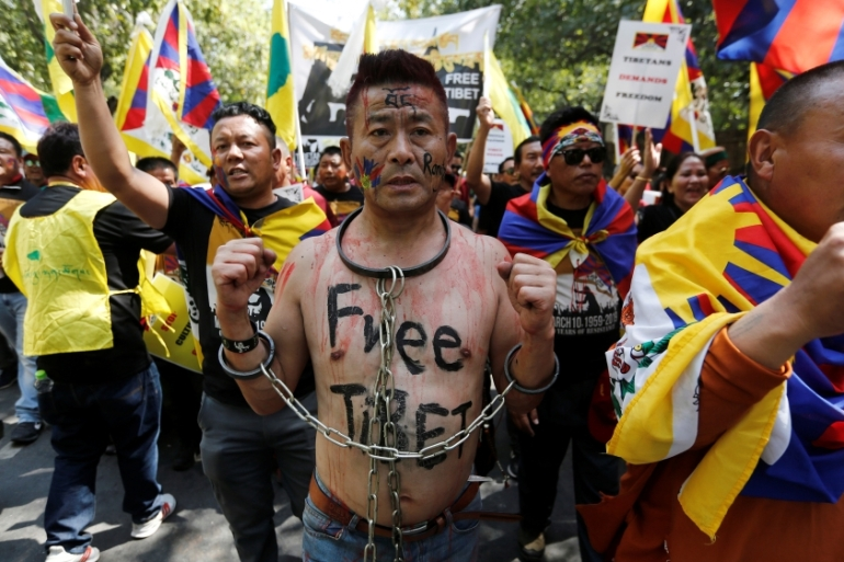 Youth organisations of Tibetan exiles held marches in Dharamsala, New Delhi and other places [Adnan Abidi/Reuters]
