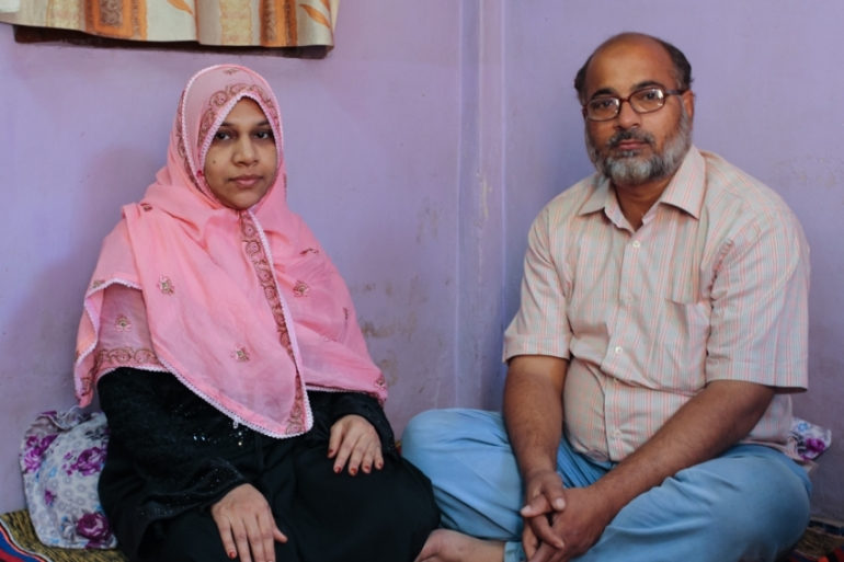 Jamil Ahmad Khan, right, and 10 others were acquitted 25 years after being accused of terrorism; here he is pictured with wife Rehana [Bilal Kuchay/Al Jazeera]