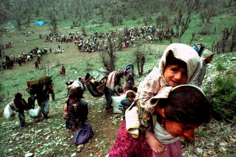 Kurdish refugees flee close to the Iraqi-Turkish border - April 20, 1992. [Yannis Behrakis/Reuters]
