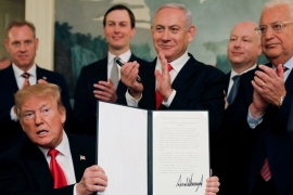 US President Donald Trump holds a proclamation recognising Israel's sovereignty over the Golan Heights as he is applauded by Israel's PM Benjamin Netanyahu on March 25, 2019 [Reuters/Carlos Barria]