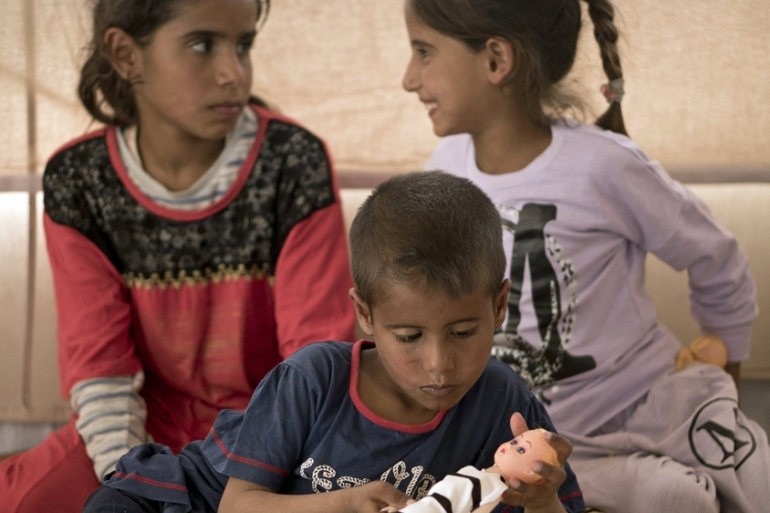 Traumatized by years of war in Iraq, many children now live a life in the margins [File:Maya Alleruzzo/AP]