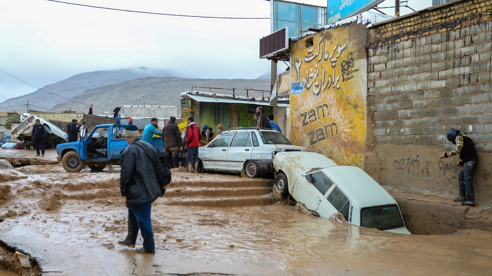 Damaged vehicles are seen after flash flooding in Shiraz last month [Tasnim News Agency/Reuters]
