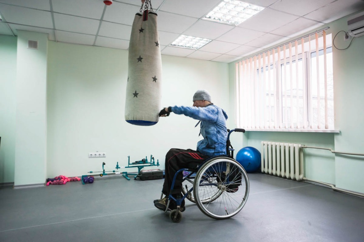 A patient in the gym of 'Donbas interregional centre for vocational rehabilitation of persons with disabilities' in Kramatorsk. Before the start of hostilities, there were 300,000 persons with disabilities in the region, the largest number in the country, because there were a lot of mines. [Erik Messori/CAPTA/Al Jazeera]