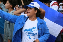 A Nicaraguan woman shouts anti-government slogans during a protest on March 16 in Managua. The government effectively banned such demonstrations last fall [Chris Kenning/Al Jazeera]