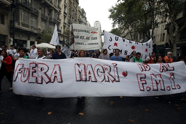Argentine unions, small firms and activists march near Argentina's Congress to demand changes in President Mauricio Macri's economic policies [Agustin Marcarian/Reuters]