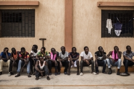 Migrants wait in the courtyard of a detention centre in the village of Karareem, around 50km from Misrata, Libya [File: Manu Brabo/AP]