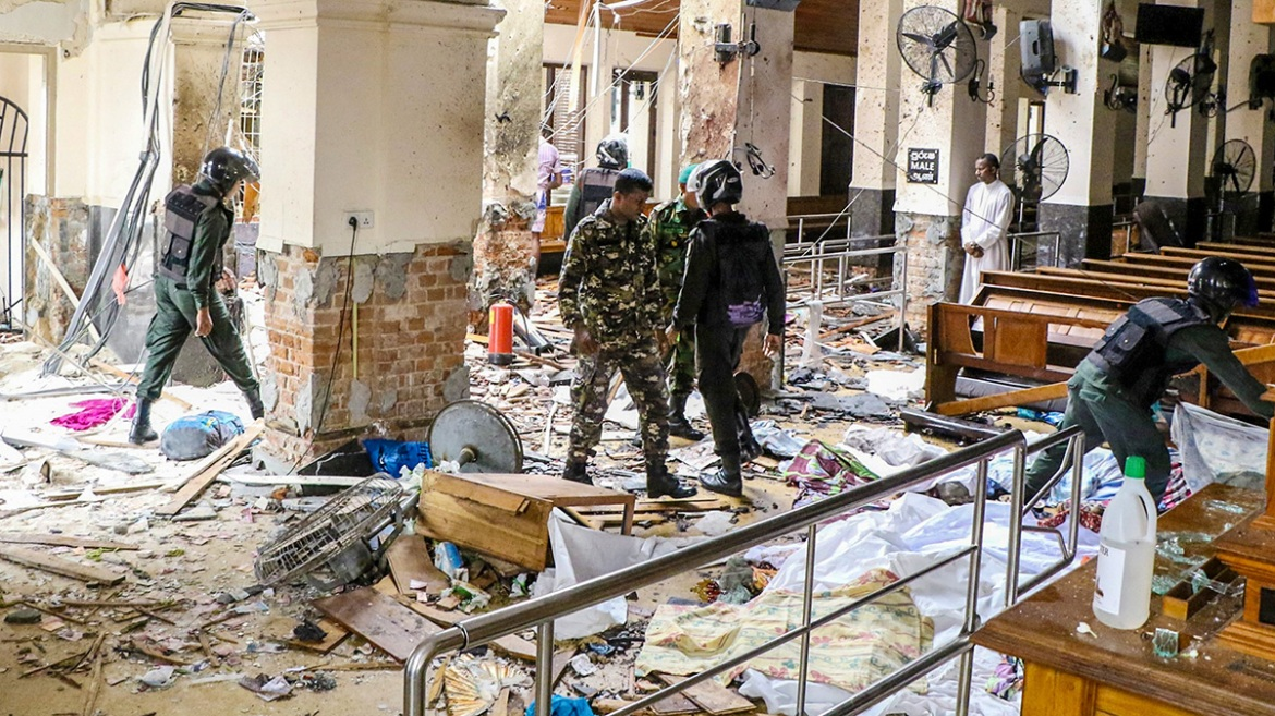 Security forces inspect St. Anthony's Shrine. Three of the explosions took place in Catholic churches, while three others were reported in the Cinnamon Grand, Kingsbury and Shangri-La hotels, located in the heart of Colombo. [Chamila Karunarathne/Anadolu Agency/Getty Images]