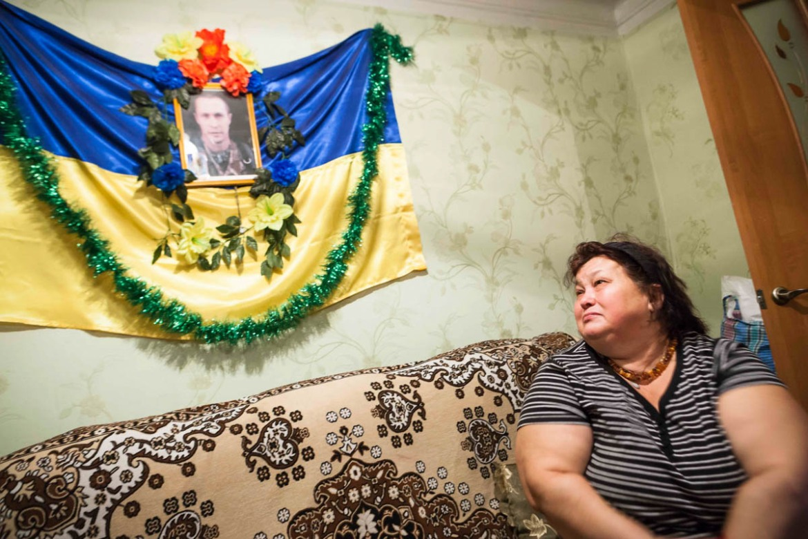 Natalia Remenuk in her house in a small hamlet near Slavyansk. The Remenuk family lost their son Andreij in the Donetsk airport battle. [Erik Messori/CAPTA/Al Jazeera]
